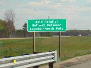 A highway sign along Route 127 in Michigan indicating the 45th Parallel - the latitude point halfway between the Equator and North Pole