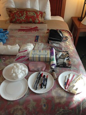 makeup tools laid out on bed