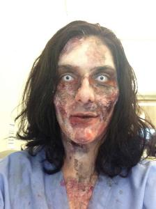 Second phase of zombie makeup, with more latex, cotton balls and fake blood and contacts