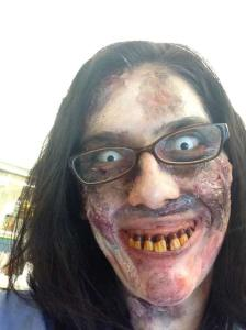 Final phase of zombie makeup, this time with my reading glasses and fake teeth
